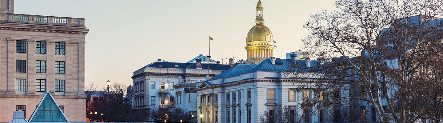 Photo of the New Jersey State House at dusk